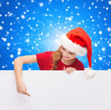 Girl in santa helper hat with blank white board Royalty Free Stock Photos