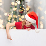 Girl in santa helper hat with blank white board Stock Photos