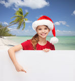 Girl in santa helper hat with blank white board Royalty Free Stock Image