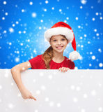Girl in santa helper hat with blank white board Stock Photography