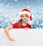Girl in santa helper hat with blank white board Stock Images