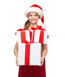 Girl in santa helper hat with many gift boxes Royalty Free Stock Image