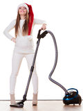 Girl in santa helper hat with vacuum cleaner Stock Photos
