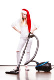 Girl in santa helper hat with vacuum cleaner Royalty Free Stock Photography