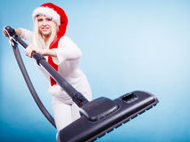 Girl in santa helper hat with vacuum cleaner Royalty Free Stock Images