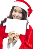 Girl in Santa holding banner. Royalty Free Stock Photos