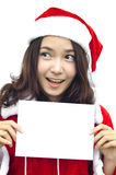 Girl in Santa holding banner. Stock Images