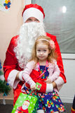 Girl with Santa Klaus Royalty Free Stock Photo