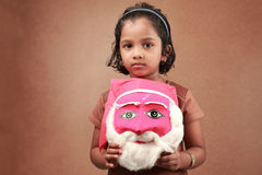 Girl with a santa mask Stock Photo