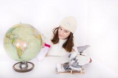 Girl with Santa nad globus Royalty Free Stock Photography