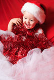 Girl santa on red cloth Royalty Free Stock Photos