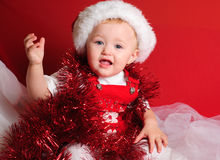 Girl santa on red cloth Stock Images