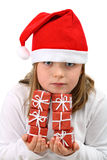 Girl in Santa red hat with six presents isolated Royalty Free Stock Images