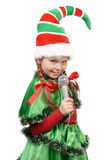 Girl - Santa's elf with a microphone Royalty Free Stock Image