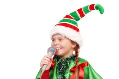 Girl - Santa`s elf with a microphone on a white Stock Images
