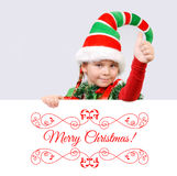 Girl Santa`s elf showing sign OK with the banner Royalty Free Stock Photos