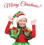 Girl - Santa`s elf showing sign OK. Stock Photography