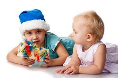 Girl in Santa's hat  and baby Stock Image
