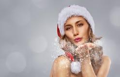 Girl in Santa's hat royalty free stock photos