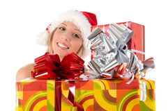 Girl with Santa's hat and colorful Christmas gifts Royalty Free Stock Photos