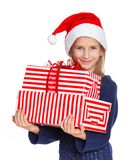 Girl in Santa's hat with gift box Stock Images
