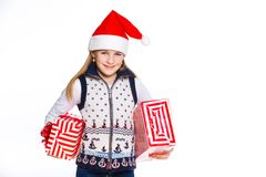 Girl in Santa's hat with gift box Stock Photography