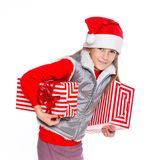 Girl in Santa's hat with gift box Stock Image