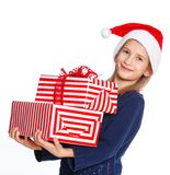 Girl in Santa's hat with gift box Stock Photos