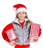 Girl in Santa's hat with gift box Royalty Free Stock Images