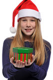 Girl with Santa's hat and holding a gift Royalty Free Stock Photo