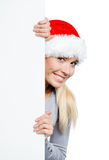 Girl in Santa's hat keeps the copyspace Stock Photography