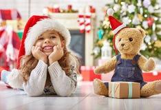 Girl in Santa's hat Stock Images