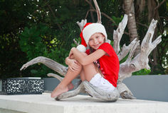 Girl in Santa's in tropics Royalty Free Stock Photos