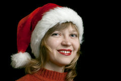 Girl in santa style hat Stock Photo