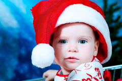 Girl in santas cap Royalty Free Stock Images