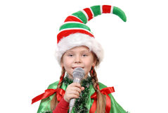 Girl - Santas elf with a microphone Royalty Free Stock Photos