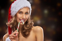 Girl in Santas hat stock photography