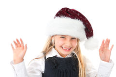 Girl with santas hat waving and smiling Royalty Free Stock Photos