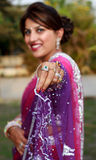 Girl in saree. Indian newly wedded girl holding saree stock photo