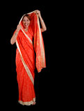 Girl in sari. Funny young girl in traditional red sari stock photos