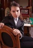 Girl sat in antique shop Stock Images