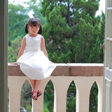 Girl sat on the balcony Royalty Free Stock Photography