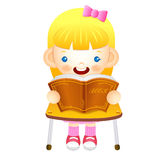 The girl sat down on the chair. Is reading a book on the desk. E Stock Image