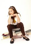 Girl sat on pile of books Royalty Free Stock Photos