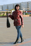 Girl with a satchel Stock Image