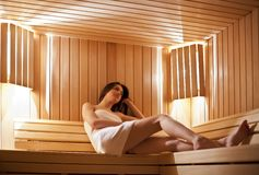 Girl in the sauna Stock Photography
