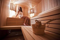Girl in the sauna. Young girl in the sauna Royalty Free Stock Image