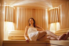 Girl in sauna. Young girl in the sauna Royalty Free Stock Photography