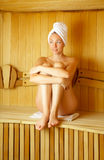 The girl in a sauna Stock Photography