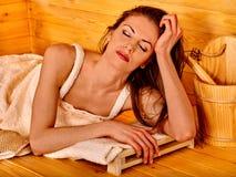 Girl in sauna Stock Image